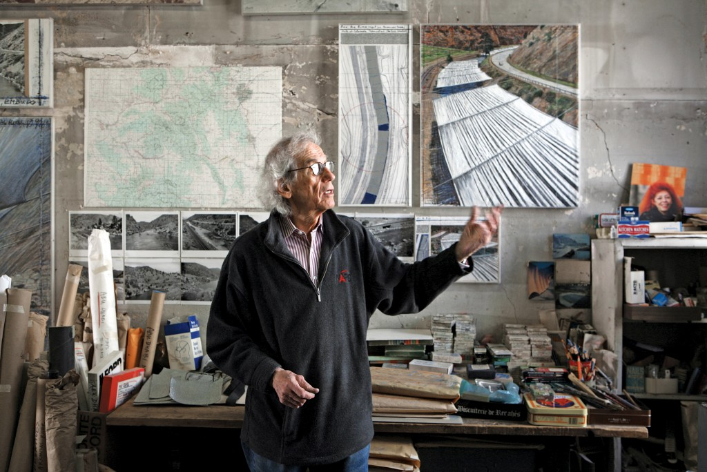 Christo in his studio with a preparatory collage for Over The River, 2011. Photo by Wolfgang Volz, © 2011 Christo