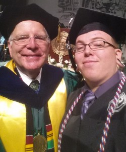Corey Clark take a selfie with Marshall University President Stephen J. Kopp at his 2014 graduation ceremony.