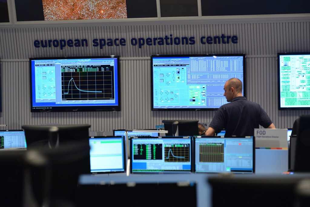 Scientists at the European Space Agency receive the first signal after the unmanned Rosetta spacecraft arrived at comet 67P/Churyumov-Gerasimenko on Aug. 6. Photo courtesy of the ESA