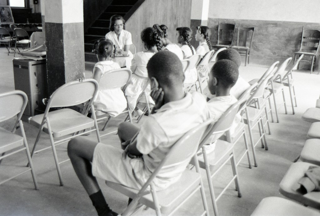 Carolyn Reese (school teacher from Detroit, Michigan), co-coordinator of the Freedom Schools in the Hattiesburg project, teaching a Freedom School class at an African-American church in Hattiesburg, Mississippi, during Freedom Summer, 1964.  Photo by Herbert Randall from Herbert Randall Freedom Summer Photographs collection, McCain Library and Archives, the University of Southern Mississippi.