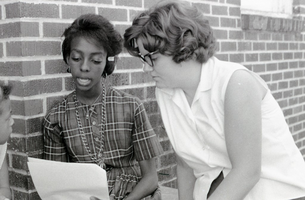 Freedom School student Cynthia Perteet (left) and volunteer Beth More (right) in Hattiesburg, Mississippi, during Freedom Summer, 1964.  More was a teacher in the Freedom School hosted by Mt. Zion Baptist Church.  Photo by Herbert Randall from Herbert Randall Freedom Summer Photographs collection, McCain Library and Archives, the University of Southern Mississippi.