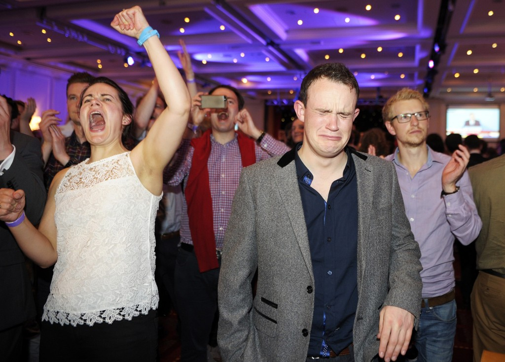 Pro-Union supporters celebrate following the announcement of referendum polling results during a 'Better Together' event in Glasgow, Scotland, on September 19, 2014. Scotland's First Minister Alex Salmond on Friday conceded defeat in his party's campaign for independence from the rest of the United Kingdom, after all but one result from the historic referendum was declared.  AFP PHOTO / ANDY BUCHANAN (Photo credit should read Andy Buchanan/AFP/Getty Images)