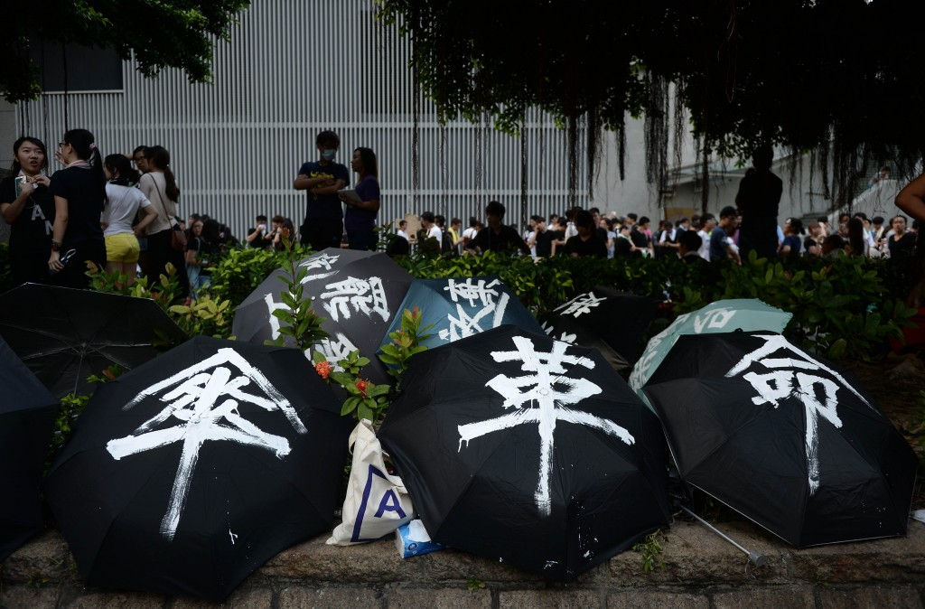 Umbrellas are used to shield demonstrators from pepper spray and the sun during a pro-democracy protest near the Hong Kong government headquarters on Sept. 29. Police fired tear gas after tens of thousands of pro-democracy demonstrators brought parts of central Hong Kong to a standstill on Sept. 28. Photo by Dale de la Rey/AFP/Getty Images