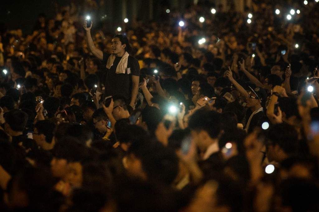 Protesters wave their mobile phones in the air in the streets outside the Hong Kong government complex on Sept. 29. Thousands of pro-democracy supporters have remained in the streets of Hong Kong for another day of protests. Photo by Chris McGrath/Getty Images