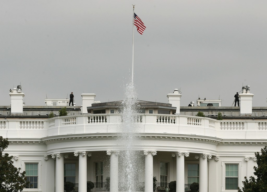 Members of the Secret Service stand guard on the roof of White House on Tuesday. White House intruder Omar Gonzalez, the man arrested last week after jumping the White House fence, went deeper into the building than what was previously reported. Photo by Mark Wilson/Getty Images