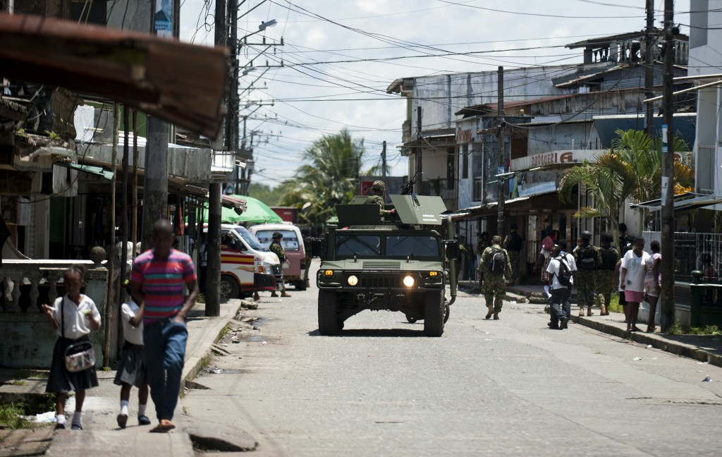 Colombian marines patrol the streets in Buenaventura, Colombia on March 25. Dueling criminal gangs have increased violence in Colombia's main port city. Photo by Luis Robayo/AFP/Getty Images