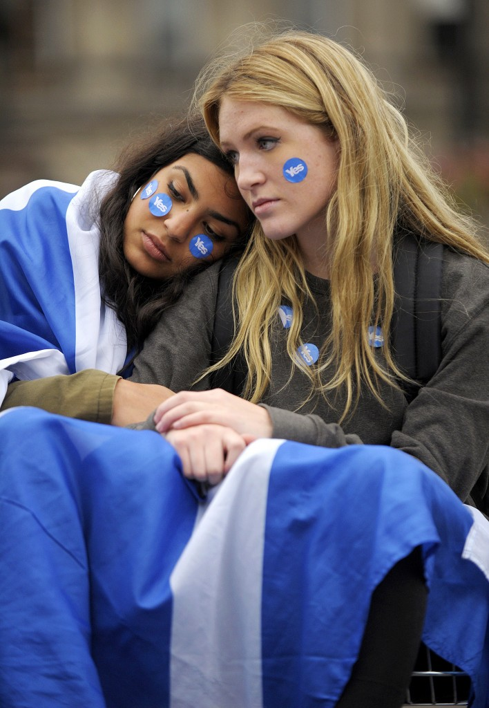 Pro-independence supporters console each other in George Square in Glasgow, Scotland, on September 19, 2014, following a defeat in the referendum on Scottish independence. Scotland rejected independence on Friday in a referendum that left the centuries-old United Kingdom intact but paved the way for a major transfer of powers away from London.  AFP PHOTO / ANDY BUCHANAN (Photo credit should read Andy Buchanan/AFP/Getty Images)