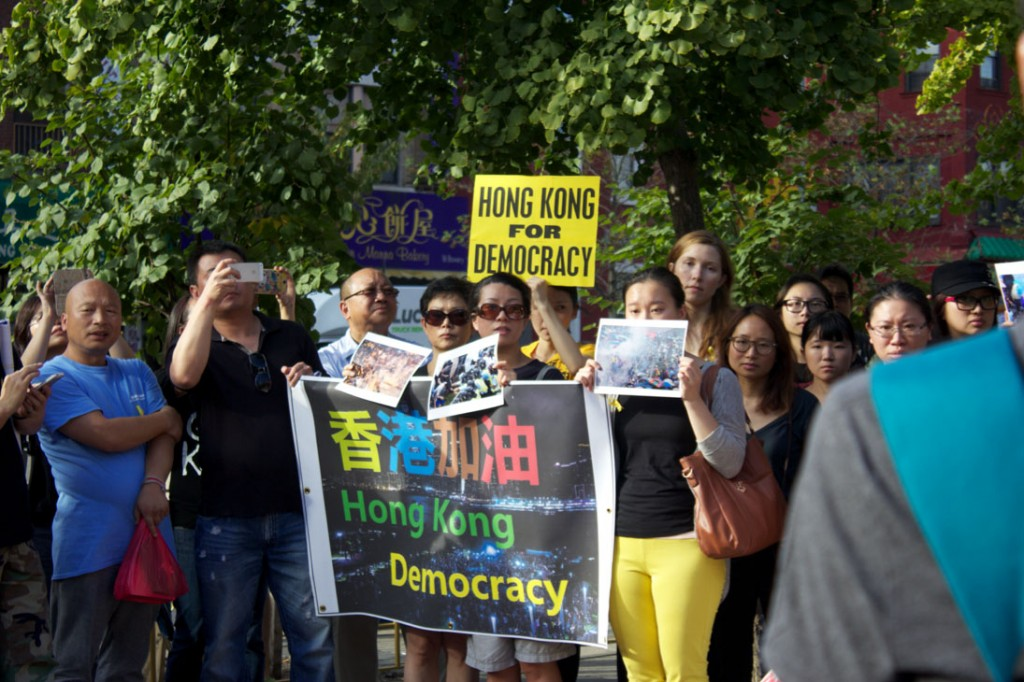 Protesters gathered in front of Confucius Plaza in Lower Manhattan Sept. 28 to show their support for pro-democracy demonstrators who had gathered in Hong Kong over the weekend. Credit: Carey Reed/ NewsHourWeekend