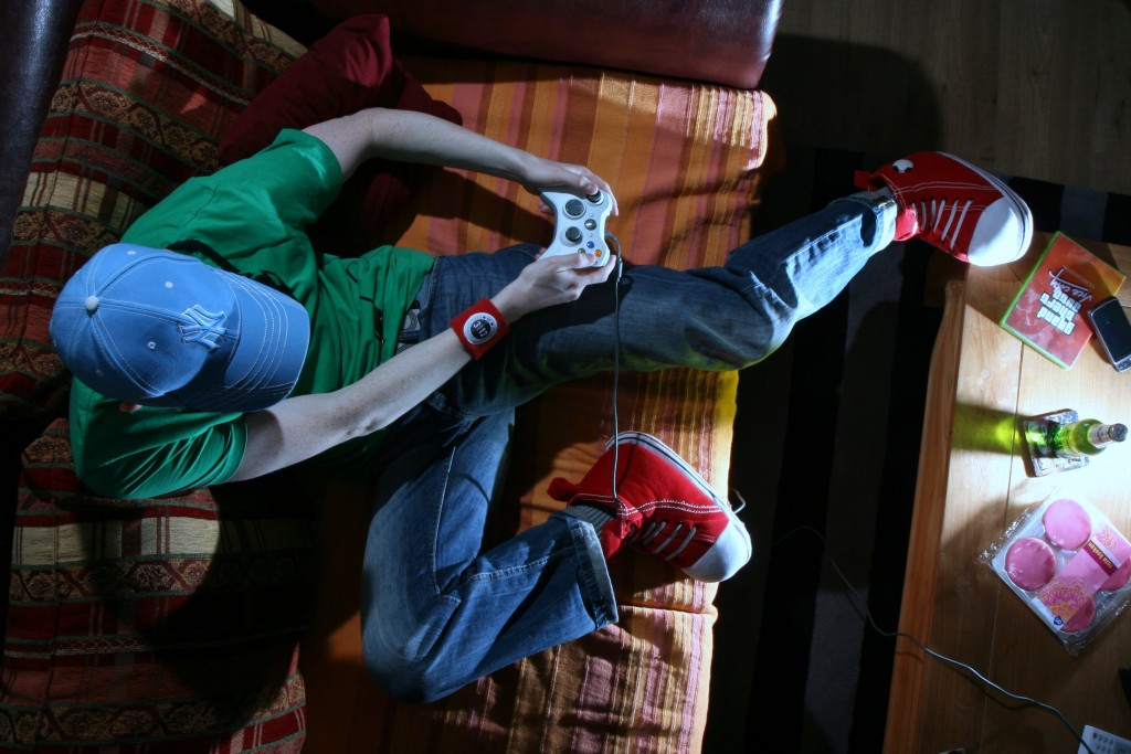 A gamer plays Grand Theft Auto at home. Image by Flickr user The World According To Marty