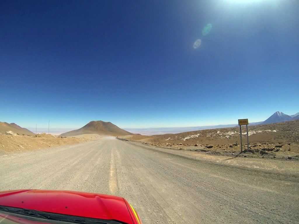 "Shortly after taking this GoPro photo, Josh passed out as we descended from ALMA's high site, an expected physiological response to high altitudes. To the right, a sign reads ""PELIGRO,"" which is ""DANGER"" in Spanish. Photo by Joshua Barajas/PBS NewsHour"