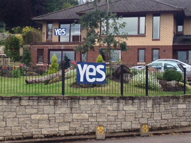 A family in Crieff, Scotland show their support for the Yes Scotland campaign. Photo by Sarah McHaney