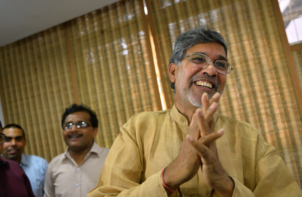 Indian activist Kailash Satyarthi meets with journalists at his home office in New Delhi after the announcement that he received the Nobel Peace Prize on Oct. 10. Photo by Chandan Khanna/AFP/Getty Images