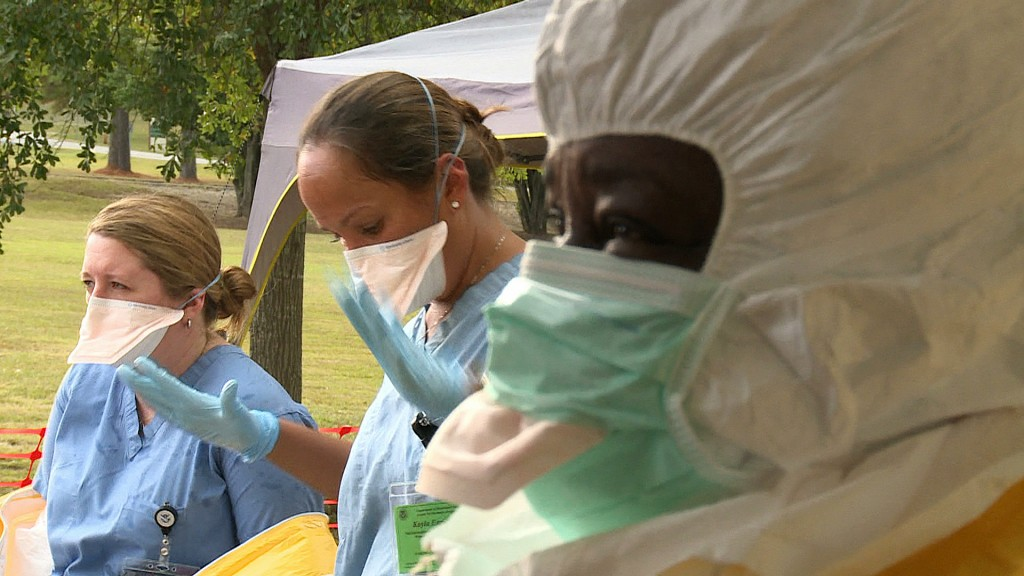 Health workers learn the proper protocols for treating Ebola. Photo by Emily Carpeaux