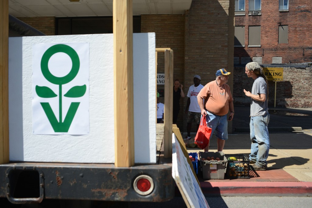 Wheeling resident Marshall Cumberlidge buys vegetables and fruits from Grow Ohio Valley's mobile market. Photo by Ariel Min/PBS NewsHour