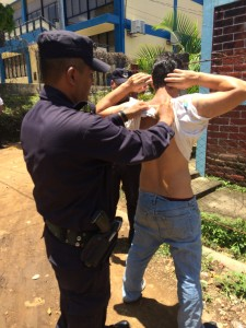 It is legal for police in El Salvador to stop and frisk people they suspect of being in a gang. Photo by Jude Joffe-Block/Fronteras Desk
