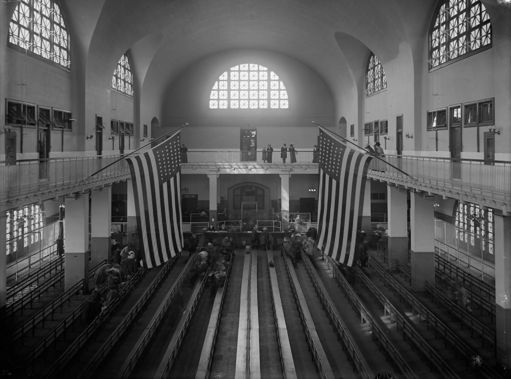 View of the Great Hall of Ellis Island Immigration Station in New York. This was taken sometime between July 4, 1908 and July 3, 1912.