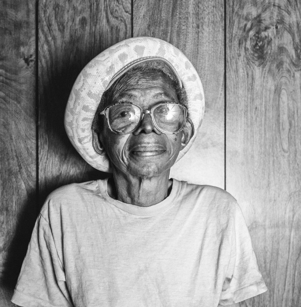 "Willie Mae Buckner and Siam, Winston-Salem, North Carolina, 1994. ""One day when I visited her, she called me into her bedroom to see something special. She lifted up her pillow and there were 10 baby pythons coiled around her Smith & Wesson. She cackled, 'Do you think anyone is going to mess with me?' Willa was one of our first artists and we made her lifelong dream come true when she performed her hilarious, risque songs in a Circus Blues show at Carnegie Hall in 1993."" Photo courtesy Tim and Denise Duffy"