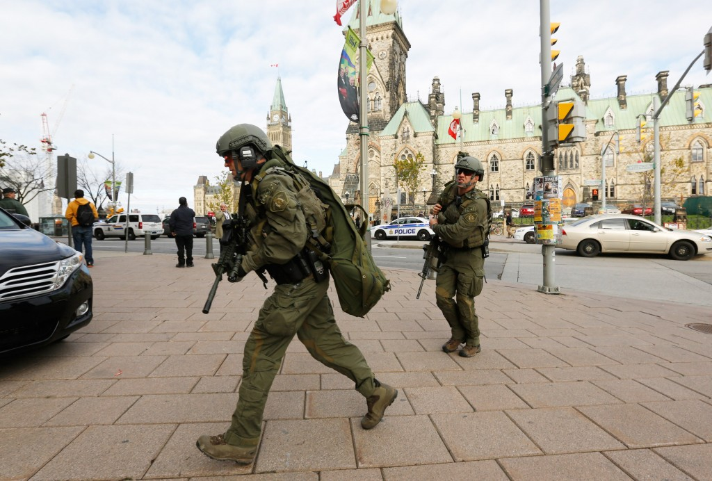 Royal Canadian mounted police officers head toward Parliament Hill following a shooting incident in Ottawa on Oct. 22. Photo by Chris Wattie/Reuters
