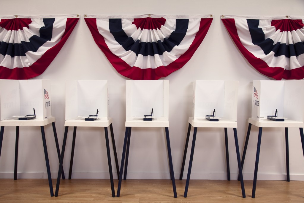 File photo of voting booths by Blend Images - Hill Street Studios a…