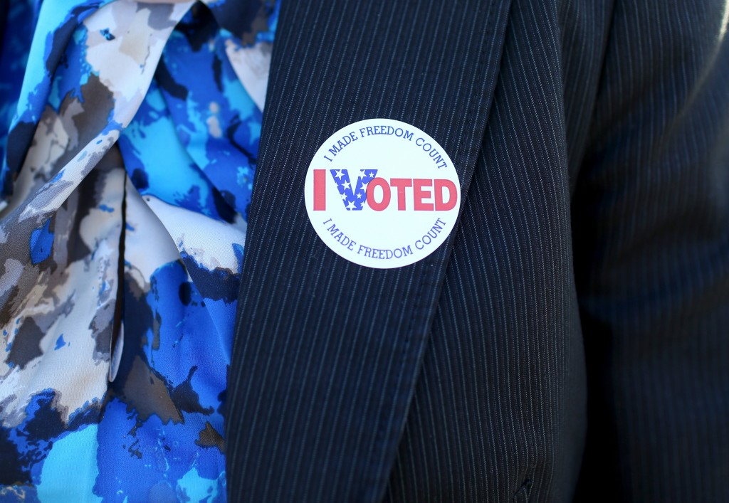 "A voter displays an ""I Voted"" sticker after casting a ballot in St. Petersburg, Florida, on Nov. 4, 2014. Photo by Joe Raedle/Getty Images"