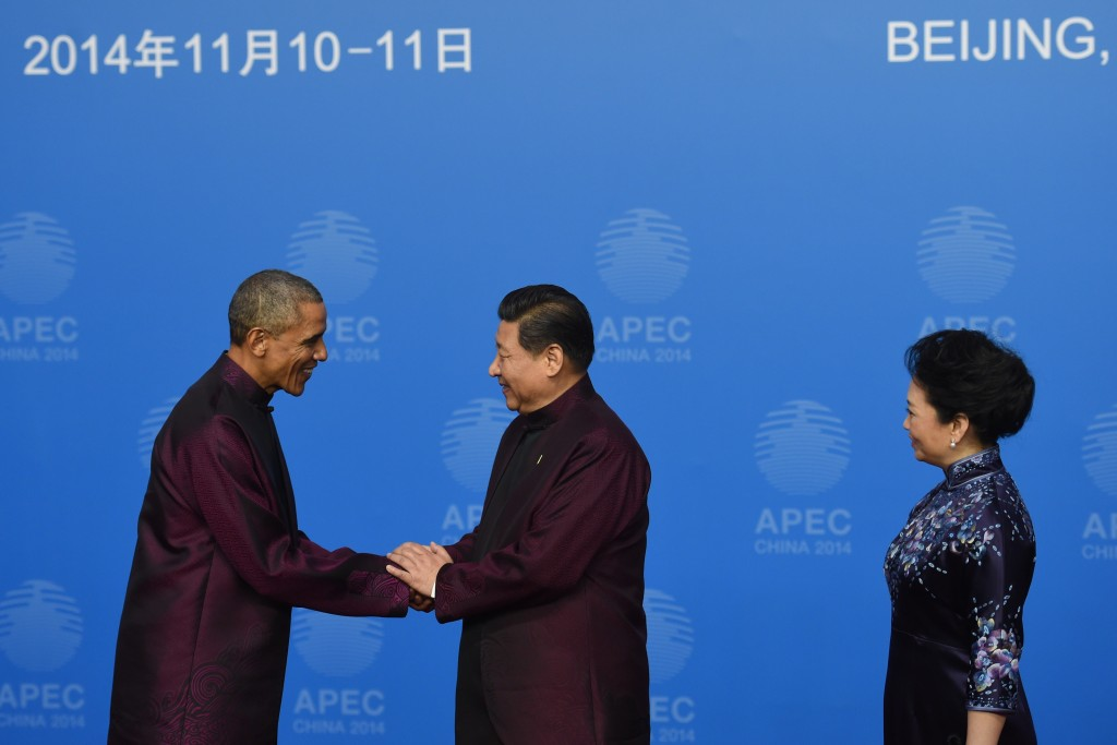 President Barack Obama (left) is greeted by Chinese President Xi Jinping (center) and his wife Peng Liyuan as he arrives for the Asia-Pacific Economic Cooperation (APEC) summit banquet at the National Aquatics Center in the Chinese capital Beijing on Nov. 10. Photo by Greg Baker/AFP/Getty Images