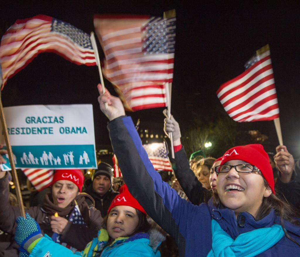 Supporters cheer in front of the White House as President Barack Obama delivers his nationally televised address on immigration reform Thursday. Photo by Paul J. Richards/AFP/Getty Images
