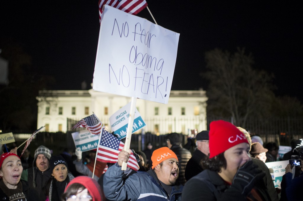 Immigration reform activists in front of the White House march and chant following President Barack Obama's speech on his executive action on immigration policies on Nov. 20, 2014. Photo By Bill Clark/CQ Roll Call