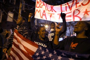 Caption:ST. LOUIS, MO - NOVEMBER 23: Demonstrators march through the streets while protesting the shooting death of 18-year-old Michael Brown on November 23, 2014 in St. Louis, Missouri. Tensions in Ferguson remain high as a grand jury is expected to decide this month if Ferguson police officer Darren Wilson should be charged in the shooting death of Michael Brown. (Photo by Justin Sullivan/Getty Images)