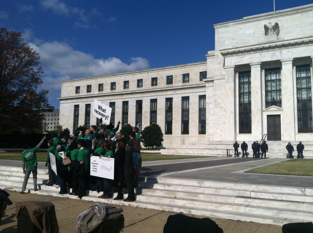 "The ""Fed Up"" campaign gathers for an Oct. 14 press conference outside the Federal Reserve before meeting with Chair Janet Yellen. Photo by Simone Pathe."