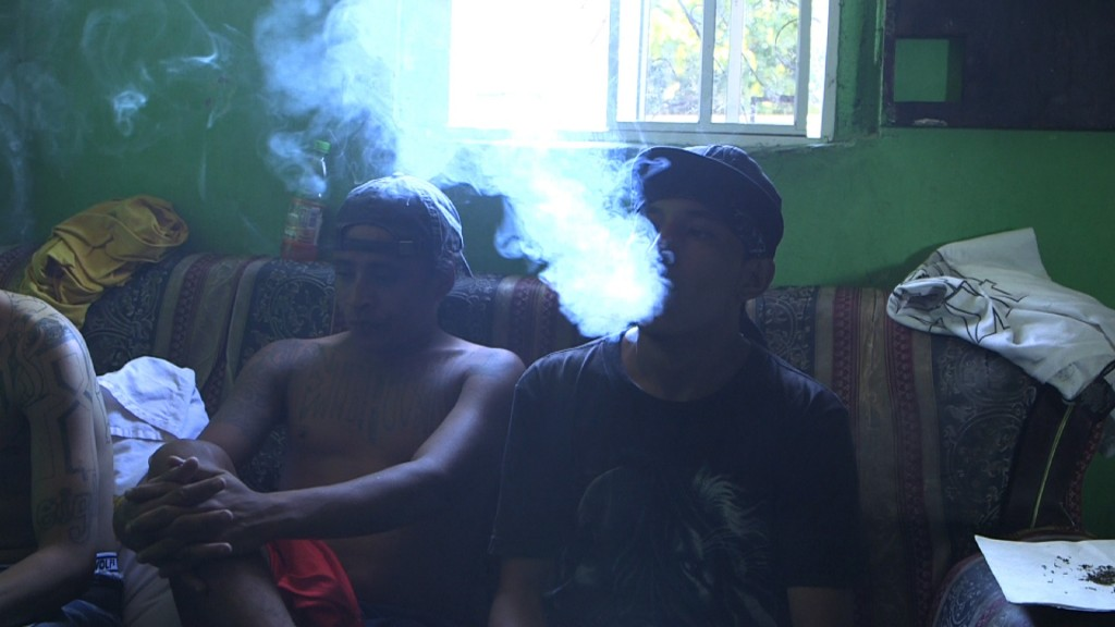 18th street gang members smoke marijuana and at a crash house in San Salvador. Credit: Brian Epstein/NewsHour