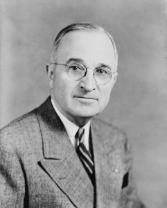 """""""Harry S Truman, bw half-length photo portrait, facing front, 1945"""" by Edmonston Studio - The Library of Congress, http://loc.gov. Licensed under Public domain via Wikimedia Commons -"""