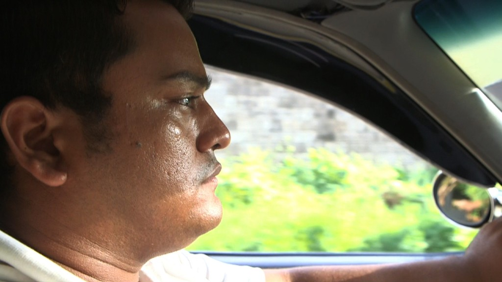 Miguel Angel Gomez, a taxi driver in San Salvador, is planning to cross into the U.S. illegally with his wife. Credit: Brian Epstein/NewsHour
