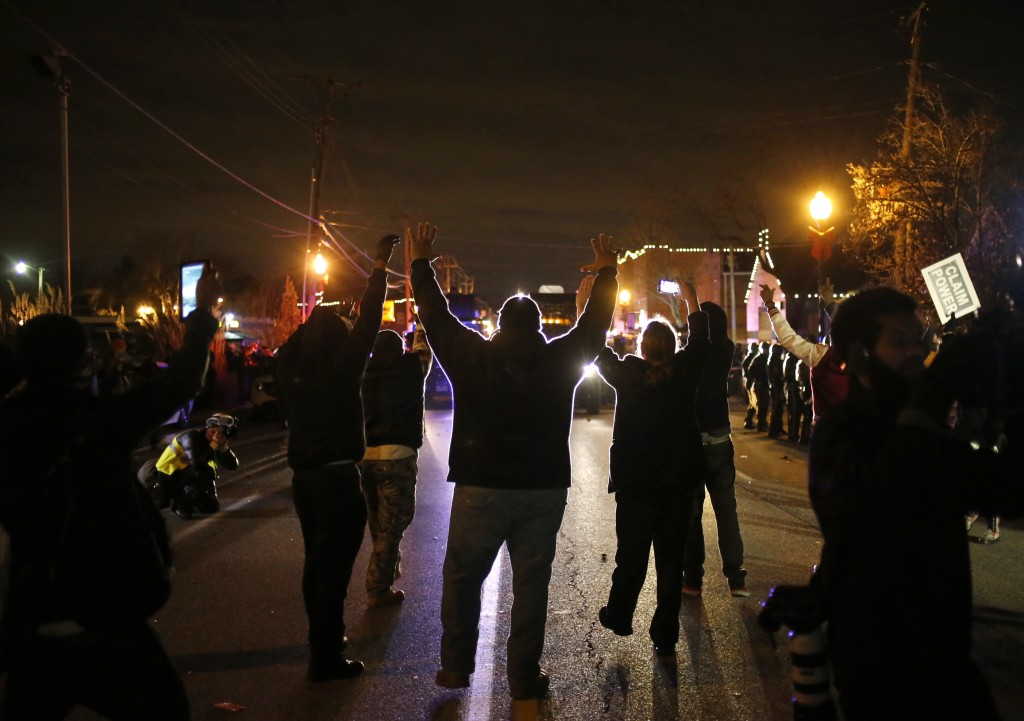 Protesters approach a police line with their hands up after a grand jury returned no indictment in the shooting of Michael Brown. Photo by Adrees Latif / REUTERS