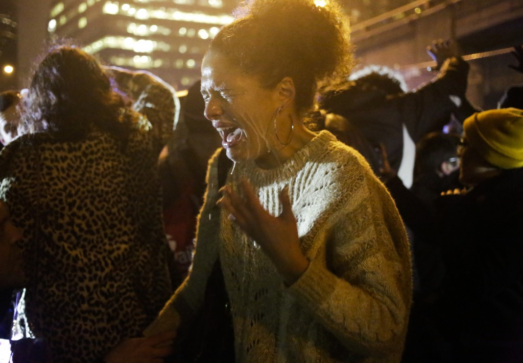 A protester reacts to being pepper sprayed by police after a group of demonstrators attempted to stop traffic on Interstate 5 following the grand jury decision in the Ferguson, Missouri shooting of Michael Brown, in Seattle, Washington, November 24. Photo by Jason Redmond