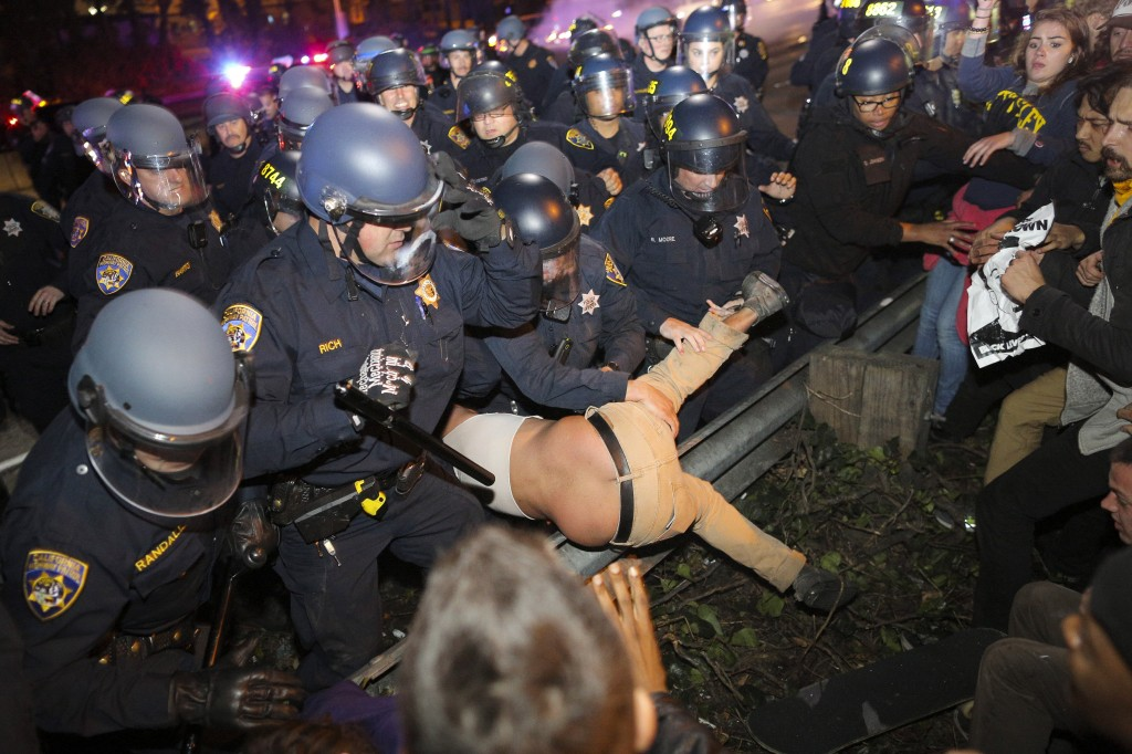 Police grab a protester during a demonstration in Oakland, California, following the grand jury decision in the shooting of Michael Brown in Ferguson, Missouri, November 24. Photo by Elijah Nouvelage