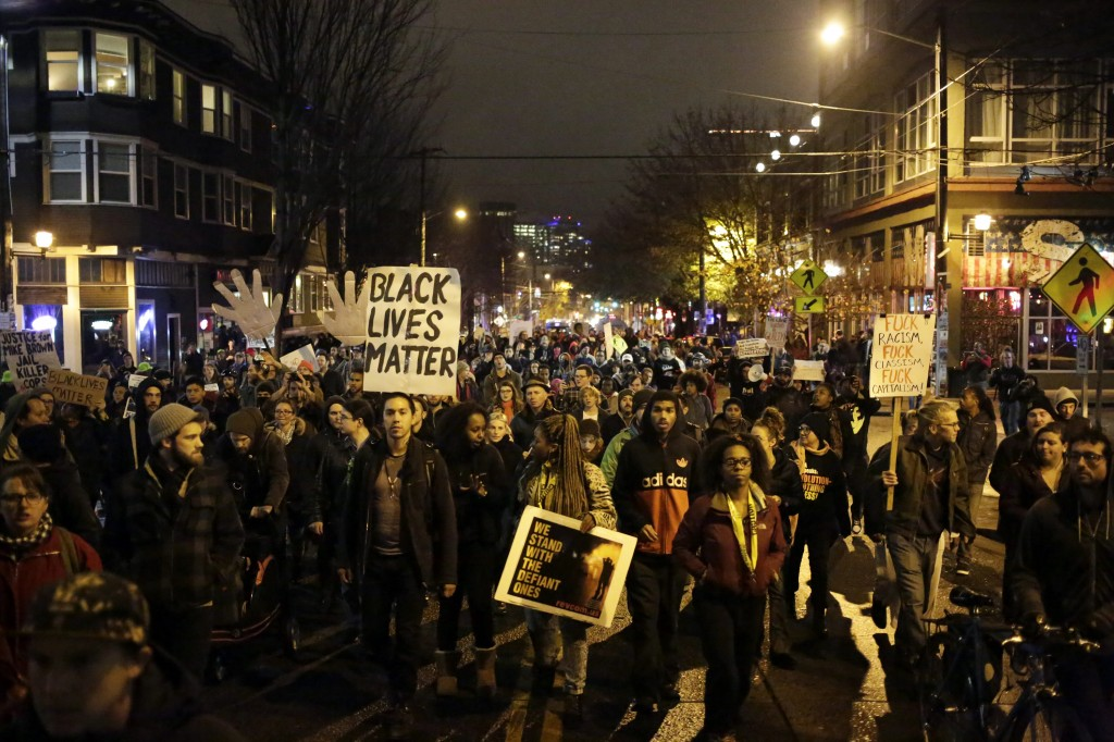 Demonstrators march through the streets following the grand jury decision in the Ferguson, Missouri shooting of Michael Brown, in Seattle, Washington November 24.  Photo by Jason Redmond