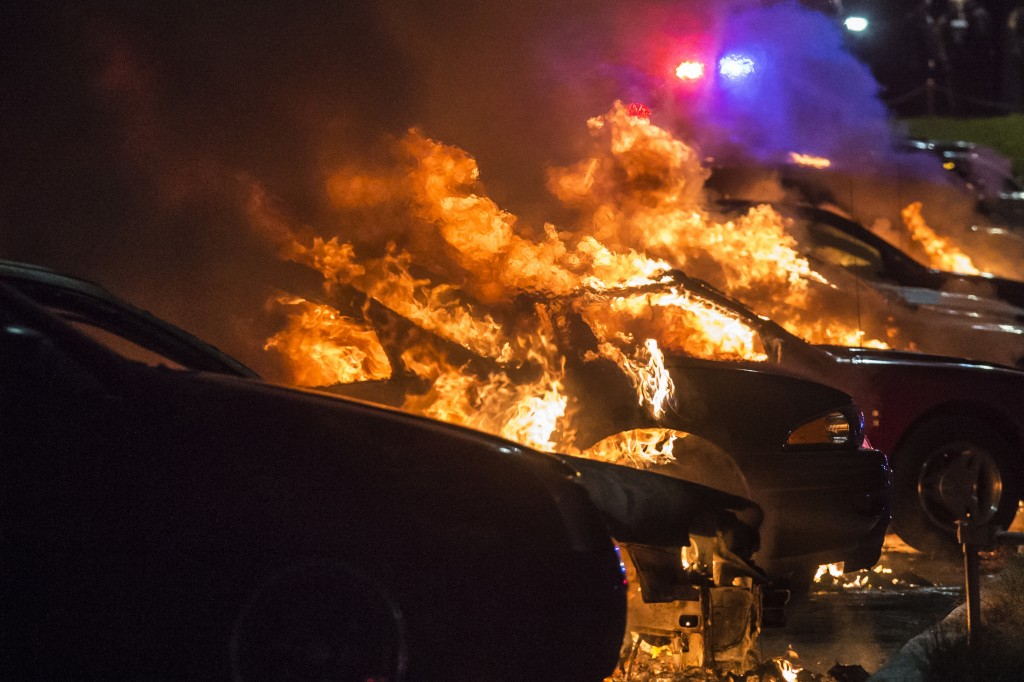 Vehicles at a car dealership are set afire in Ferguson, Missouri early morning November 25.  Photo by Adrees Latif