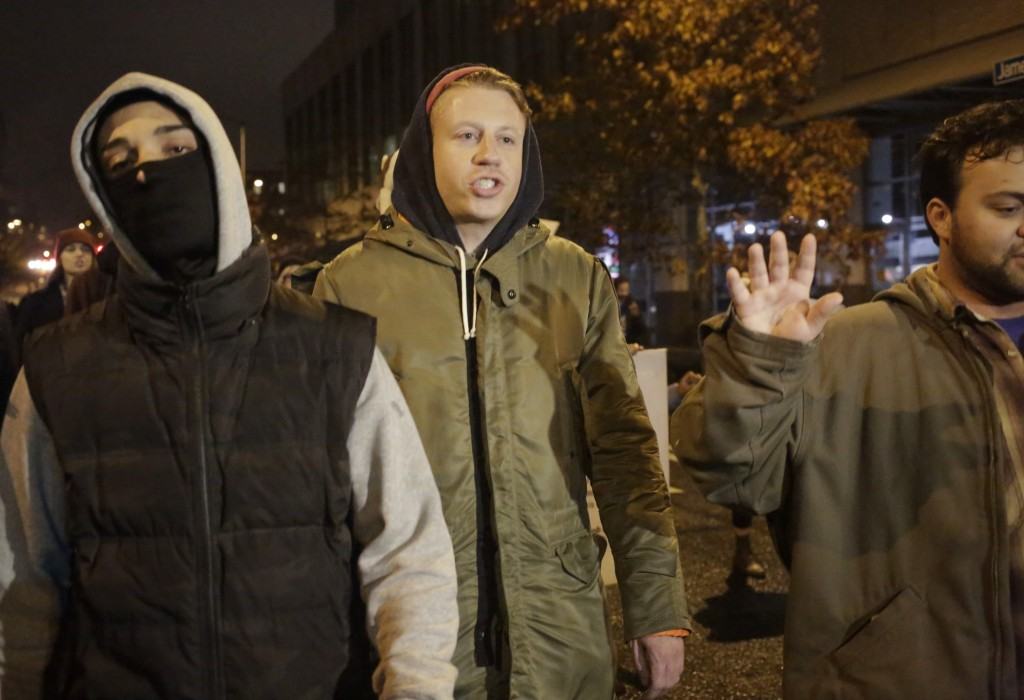 Rapper Macklemore walks with demonstrators following the grand jury decision in the Ferguson, Missouri shooting of Michael Brown, in Seattle, Washington November 24. Photo by Jason Redmond