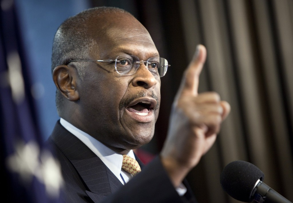 alk show host Herman Cain speaks during a press conference by the T…