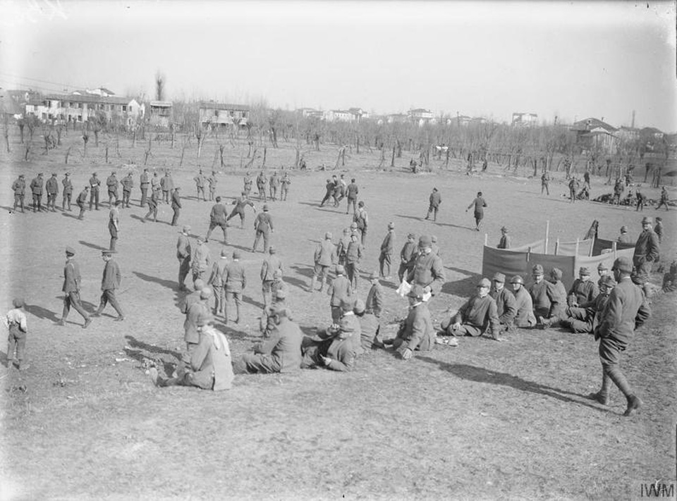 An impromptu game of football kicks off between British and Italian troops, as others take some time out to rest on the hills and watch on in 1917. Photo courtesy of Imperial War Museum