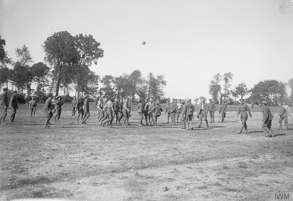 A large group of the 1st Battalion, Wiltshire Regiment join in on a football match, France in 1916. Photo courtesy of Imperial War Museum