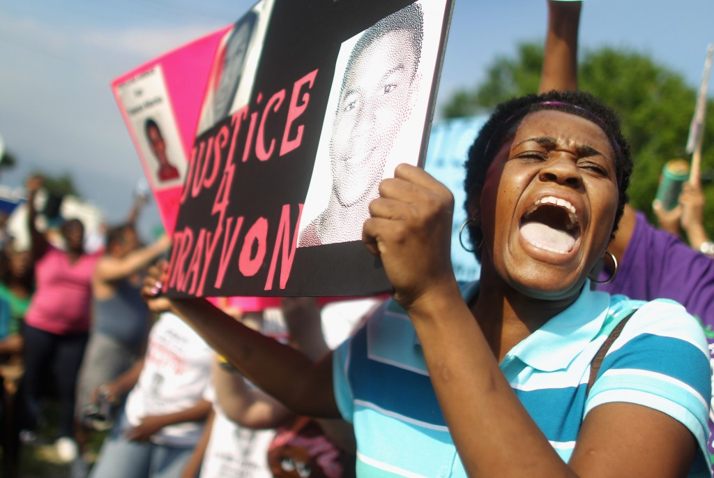 ANFORD, FL - MARCH 22: Lakeshe Hall demonstrates at a protest rally supporting slain teenager Trayvon Martin on March 22, 2012 in Sanford, Florida. Sanford Police Department Chief Bill Lee announced today he will temporarily step down following the killing of the black unarmed teenager by a white and Hispanic neighborhood watch captain. Sharpton organized today's rally. (Photo by Mario Tama/Getty Images)