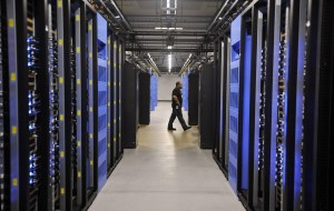 FOREST CITY, NC - APRIL 19: An employee walks past servers in one of four server rooms at the new Facebook Data Center on April 19, 2012 in Forest City, North Carolina. The company began construction on the facility in November 2010 and went live today, serving the 845 million Facebook users worldwide. (Photo by Rainier Ehrhardt/Getty Images)