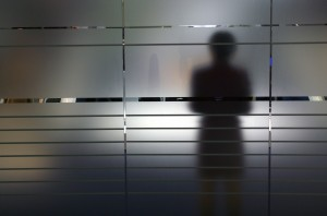 GERMANY - SEPTEMBER 09: Shadow of a woman on a frosted glass pane, Symbolic photo to the topics: anonymity, fear, uncertainty, unsteadiness, personal secrets etc. (Photo by Ulrich Baumgarten via Getty Images)