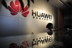 A receptionist sits behind the counter at the Huawei office in Wuhan, central China's Hubei province in 2012. Photo by STR/AFP/GettyImages
