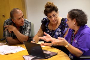 MIAMI, FL - OCTOBER 08: Affordable Care Act navigator Nini Hadwen (R) speaks with Jorge Hernandez (L) and Marta Aguirre as they shop for health insurance during a navigation session put on by the Epilepsy Foundation Florida to help people sign up for health insurance under the Affordable Care Act on October 8, 2013 in Miami, Florida. The United States government continues to be partially shut down as Republicans hold out hope to cut funding for the Affordable Care Act. (Photo by Joe Raedle/Getty Images)