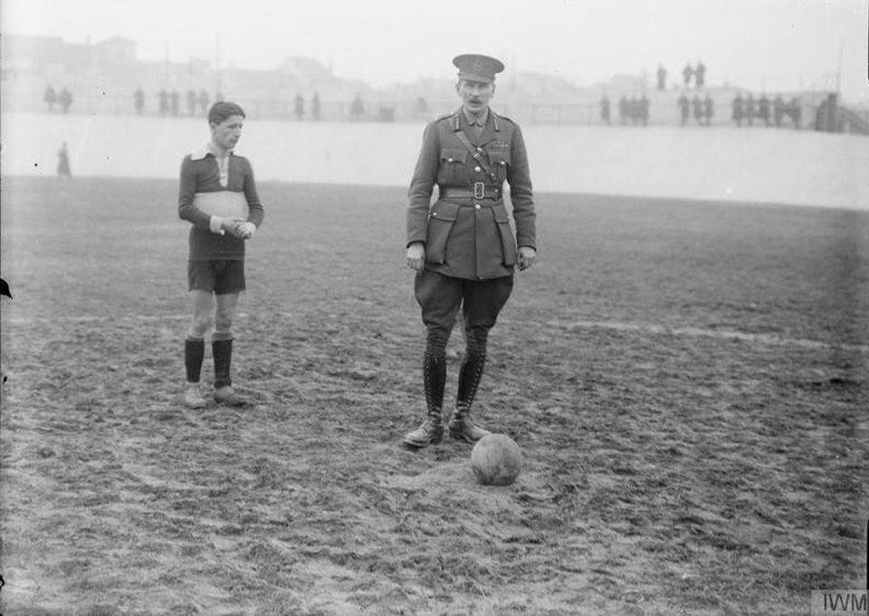 A British general is about to kick off a friendly football match between the British and Italian troops on the Italian Front in 1917. Photo courtesy of Imperial War Museum