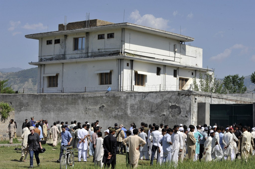 Pakistani media and local residents gather outside the hideout of Al-Qaida leader Osama bin Laden following his death by U.S. special forces in Abbottabad on May 1-2, 2011. Photo by Aamir Qureshi/AFP/Getty Images