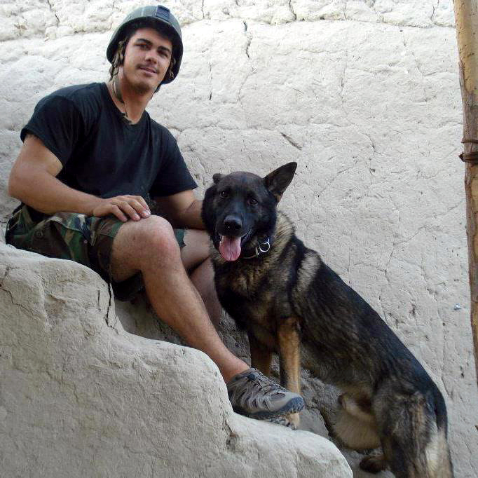 Marine Lance Cpl. Joshua Ashley and his war dog Sirius. Photo from Memorial for Cpl. Joshua Ryan Ashley Facebook page