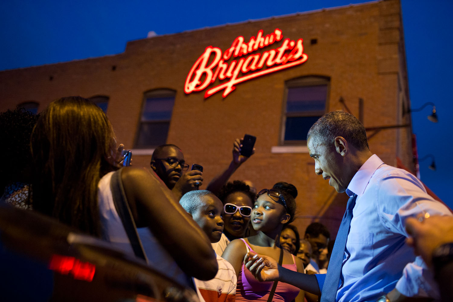 The president greets a crowd outside Arthur Bryant's Barbeque in Kansas City. Official White House photo by Pete Souza.